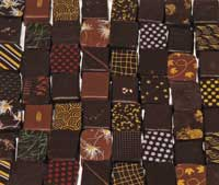 Array of rectangular chocolates with decorated flat tops