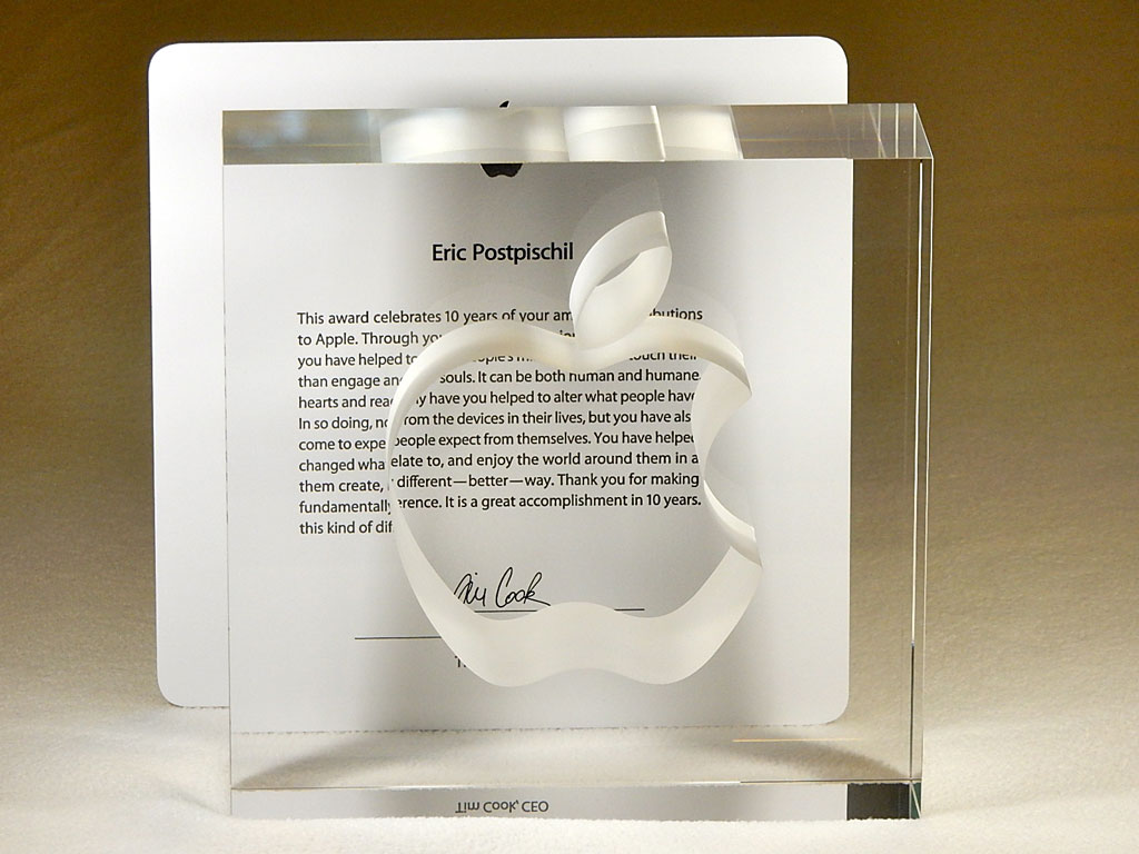 Lead crystal block with Apple logo in front of Apple ten-year service award letter